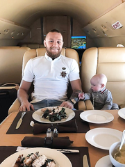 Mcgregor with his son on the jet.