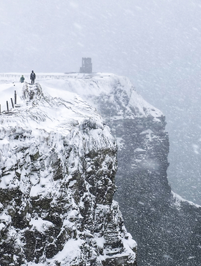 A view of the Cliffs of Moher Snowing.