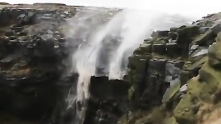 Waterfall up by strong winds.