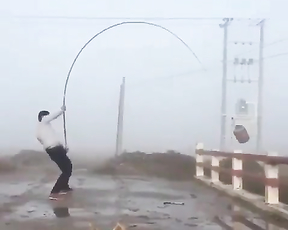 That's a fishing rod being stress tested. Lol