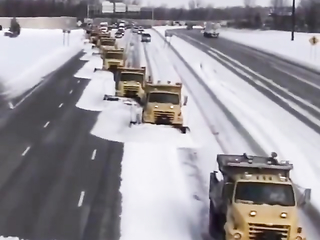 Team work on cleaning snow on the street.