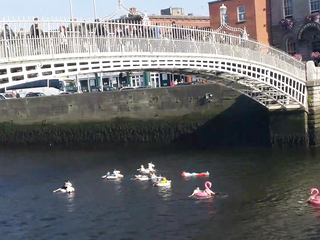 Group of lads seen floating along Dublin's River Liffey.
