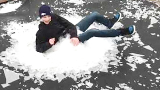 Kid Breaks the Ice on Frozen Trampoline