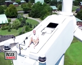 Watch Man Get Caught By a Drone Sunbathing on a Wind Turbine