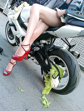 The motorbike ate her skirt. Lol