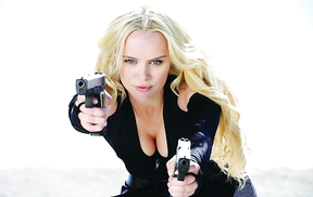 Photos of famous actresses with guns in their hands