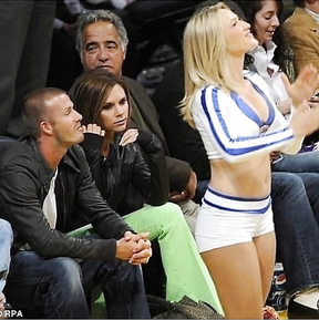 David Becham was catch by his wife Victoria Becham when he was watching...
