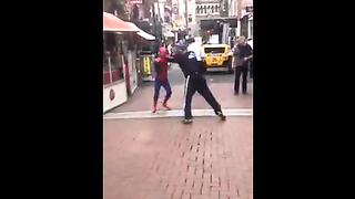 Junkie in Dublin tries to steal money from Spider-Man street performer