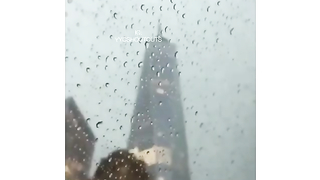 Lighting hits the top of tower. Slow motion. Cool