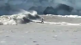 Surfing on Alascka cold water.