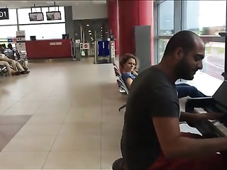 Guy Walks Over To A Piano
