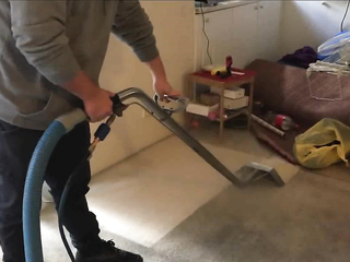 Heavily soiled carpet cleaning using a truck mount carpet cleaning machine.